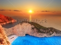 stock-photo-a-panorama-of-sunset-over-zakynthos-island-greece-with-a-shipwreck-on-the-sandy-beach-58611775
