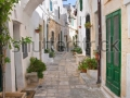 stock-photo-alleyway-ostuni-puglia-italy-106328222