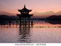 stock-photo-ancient-pavilion-on-the-west-lake-with-sunset-in-hangzhou-china-126783089