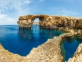 stock-photo-azure-window-famous-stone-arch-of-gozo-island-in-the-sun-in-summer-malta-141789496