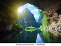 stock-photo-beautiful-view-on-the-mountain-from-the-grotto-tam-coc-national-park-vietnam-80043013
