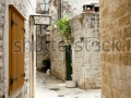 stock-photo-beauty-old-narrow-alley-in-unesco-town-trogir-croatia-104545532
