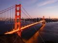stock-photo-close-up-of-the-golden-gate-bridge-reflecting-orange-lights-in-water-and-illuminated-city-skyline-148570109