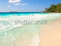 stock-photo-exotic-beach-at-seychelles-with-turquoise-water-in-summer-waves-at-the-beach-in-the-lagoon-145946996