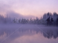 stock-photo-fog-and-mist-hang-over-reflection-lake-as-dawn-breaks-mount-rainier-national-park-washington-62124556