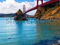 stock-photo-golden-gate-bridge-great-view-from-the-water-s-edge-near-the-foot-of-the-bridge-bright-sunny-day-107946551