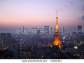 stock-photo-light-up-tokyo-tower-during-sunset-surrounded-by-other-buildings-in-tokyo-japan-47982301