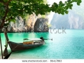stock-photo-long-boat-on-island-in-thailand-80417863