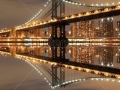 stock-photo-manhattan-bridge-and-manhattan-skyline-at-night-new-york-city-98018609