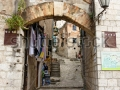 stock-photo-narrow-street-in-old-unesco-town-of-kotor-montenegro-82863112