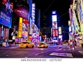 stock-photo-new-york-city-dec-times-square-is-a-busy-tourist-intersection-of-neon-art-and-commerce-and-112751527