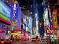 stock-photo-new-york-city-june-times-square-is-a-busy-tourist-intersection-of-neon-art-and-commerce-and-is-105038657