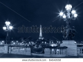 stock-photo-night-illumination-on-the-bridge-of-alexander-iii-and-eiffel-tower-in-the-background-paris-france-84049558