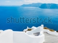 stock-photo-santorini-island-greece-beautiful-view-of-blue-ocean-and-traditional-dome-church-architecture-106946036