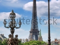 stock-photo-street-lanterns-on-the-bridge-alexandre-iii-and-the-eiffel-tower-in-paris-france-112828519