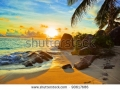 stock-photo-tropical-beach-at-sunset-nature-background-90617686