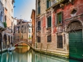 stock-photo-venice-cityscape-narrow-water-canal-bridge-and-traditional-buildings-italy-europe-149895788