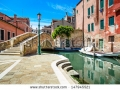 stock-photo-venice-cityscape-narrow-water-canal-bridge-boats-and-traditional-buildings-italy-europe-147945521