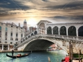 stock-photo-venice-rialto-bridge-and-with-gondola-on-grand-canal-italy-130126373