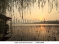 stock-photo-west-lake-in-hangzhou-in-the-evening-133370486