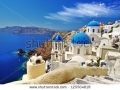 stock-photo-white-blue-santorini-view-of-caldera-with-domes-125504618