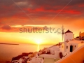 stock-photo-windmill-against-colorful-sunset-santorini-greece-111191678