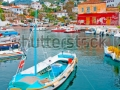 stock-photo-wooden-fishing-boat-in-the-beautiful-small-harbour-kamini-of-hydra-island-in-saronikos-gulf-in-89133739