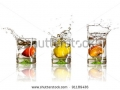 stock-photo-drinks-with-splashing-citrus-fruits-over-white-91189436
