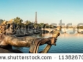stock-photo-panorama-on-the-alexander-iii-bridge-with-the-eiffel-tower-in-the-background-paris-france-113826709