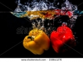 stock-photo-pepper-dropped-into-water-with-splash-159641276