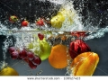 stock-photo-splashing-fruit-on-water-fresh-fruit-and-vegetables-being-shot-as-they-submerged-under-water-108527423