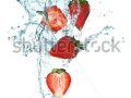 stock-photo-splashing-strawberry-into-a-water-101697886