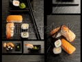 stock-photo-sushi-collection-on-black-background-51365344