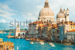 stock-photo-gorgeous-view-of-the-grand-canal-and-basilica-santa-maria-della-salute-during-sunset-with-124543123