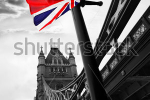 stock-photo-london-tower-bridge-with-colorful-flag-of-england-95881024