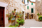 stock-photo-majorca-valldemossa-typical-village-with-flower-pots-in-facades-at-spain-86173156