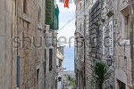 stock-photo-narrow-street-in-old-medieval-town-korcula-by-night-croatia-dalmatia-region-europe-30417475