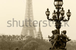 stock-photo-street-lantern-on-the-alexandre-iii-bridge-against-the-eiffel-tower-in-paris-france-80384110