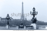 stock-photo-street-lantern-on-the-alexandre-iii-bridge-against-the-eiffel-tower-in-paris-france-80454073