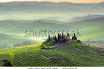 stock-photo-sunrise-over-the-italian-countryside-tuscany-118709218