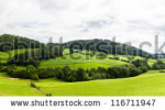 stock-photo-broad-panorama-of-the-countryside-in-north-wales-with-green-field-in-foreground-116711947