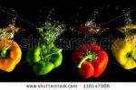 stock-photo-four-several-coloured-paprika-falling-into-water-before-black-background-116147986