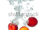 stock-photo-isolated-shot-of-peach-falling-into-water-isolated-on-white-background-148776554