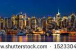 stock-photo-manhattan-midtown-skyline-panorama-at-dusk-new-york-city-152330468