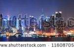stock-photo-new-york-city-manhattan-midtown-skyline-at-night-with-skyscrapers-lit-over-hudson-river-with-116087059