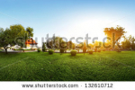 stock-photo-panorama-of-a-green-garden-with-buddhist-building-and-meadow-with-grass-at-early-morning-132610712