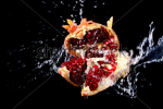 stock-photo-pomegranate-in-water-splashes-isolated-on-black-23612878