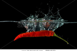 stock-photo-red-hot-chili-pepper-splashing-into-water-58845172