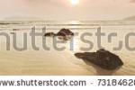 stock-photo-sunrise-over-the-sea-in-sepia-panorama-73184620