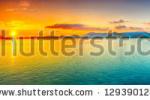 stock-photo-sunrise-over-the-sea-panorama-129390128